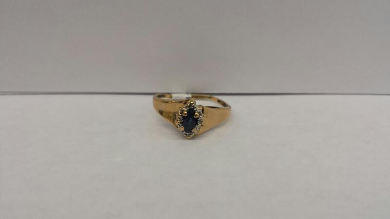 10k Yellow Gold Ring with 1 Blue Stone and 2 Diamond Chips