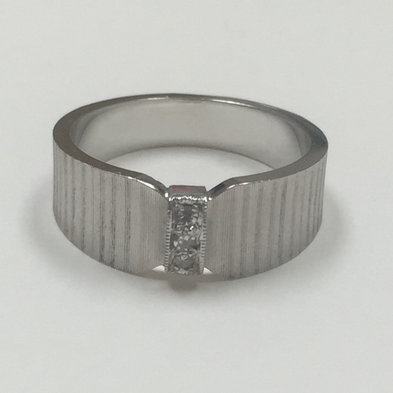 Lady's Diamond Fashion Ring 3 Diamonds .03 Carat T.W. 14K White Gold 3.1dwt