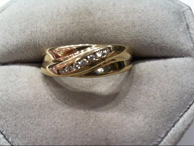 Lady's Diamond Wedding Band 7 Diamonds .14 Carat T.W. 10K Yellow Gold 2.5g