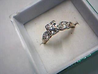 Lady's Diamond Fashion Ring 3 Diamonds .30 Carat T.W. 14K Yellow Gold 2.7g