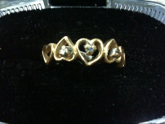 Lady's Diamond Fashion Ring 3 Diamonds .03 Carat T.W. 14K Yellow Gold 2.2g