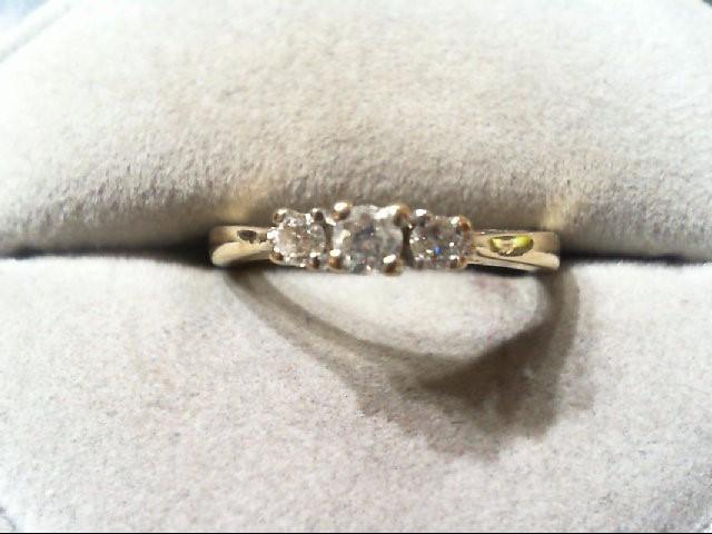 Lady's Diamond Wedding Band 3 Diamonds .26 Carat T.W. 14K Yellow Gold 2.8g