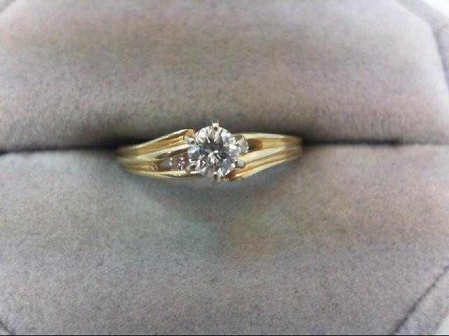 Lady's Diamond Engagement Ring 3 Diamonds .22 Carat T.W. 14K Yellow Gold 2g