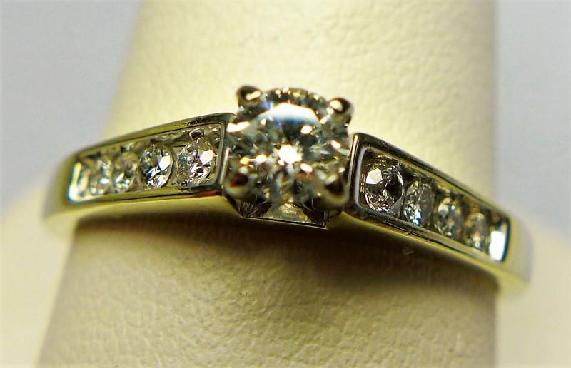 Lady's Diamond Fashion Ring 9 Diamonds .18 Carat T.W. 14K White Gold 2.8g