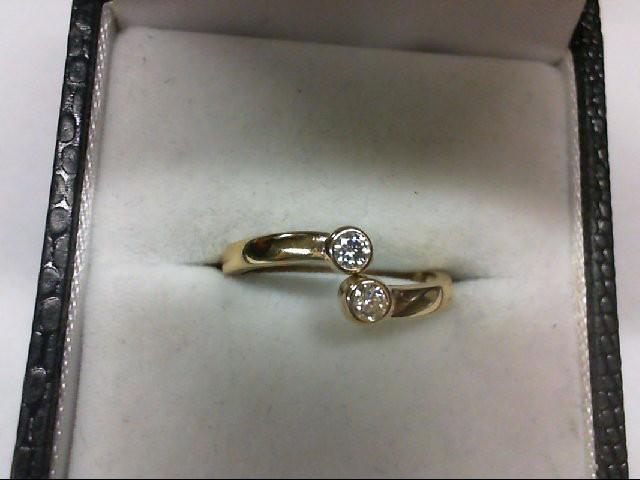 Lady's Diamond Fashion Ring 2 Diamonds 0.14 Carat T.W. 14K Yellow Gold 1.5g