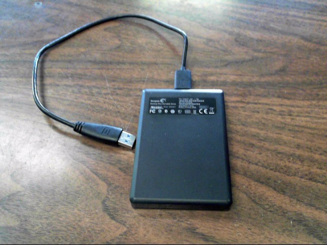 BACKUP/ PORTABLE HARD DRIVE: SEAGATE MODEL SRD00F1, 1TB Storage