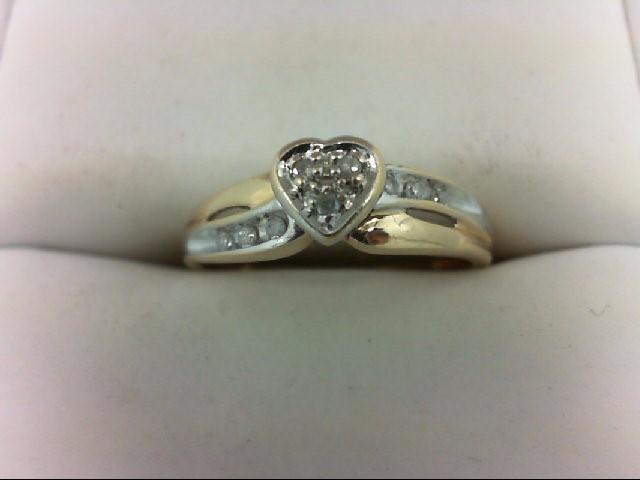 Lady's Diamond Cluster Ring 9 Diamonds 0.09 Carat T.W. 10K Yellow Gold 2.3g