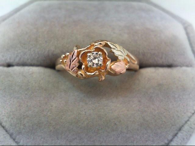 Lady's Diamond Fashion Ring .12 CT. 10K Tri-color Gold 3.1g