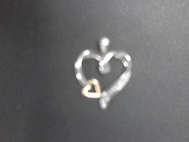Silver-Diamond Pendant 10 Diamonds .050 Carat T.W. 925 Silver 1.4g