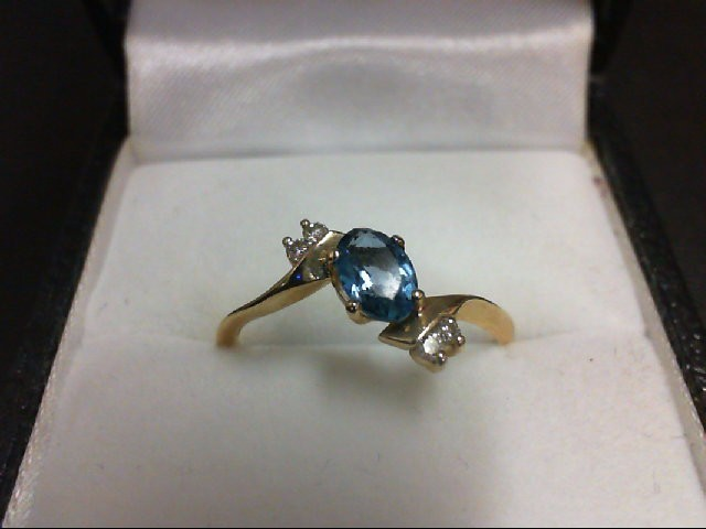 Blue Topaz Lady's Stone & Diamond Ring 4 Diamonds 0.08 Carat T.W. 10K Yellow Gol