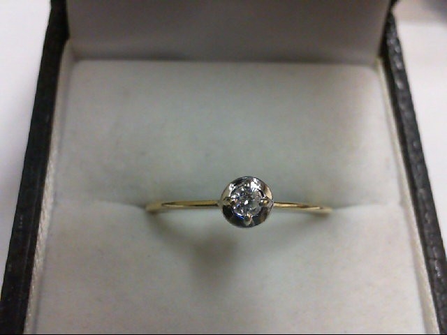Lady's Diamond Solitaire Ring 0.07 CT. 10K Yellow Gold 1.1g
