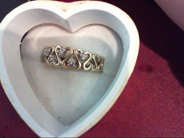 Lady's Diamond Fashion Ring 5 Diamonds .05 Carat T.W. 14K Yellow Gold 2.5g