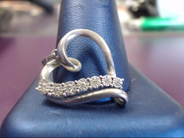 Silver-Diamond Pendant 7 Diamonds .07 Carat T.W. 925 Silver 2.43g