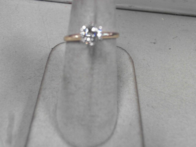 Lady's Diamond Solitaire Ring .68 CT. 14K Yellow Gold 2.2g