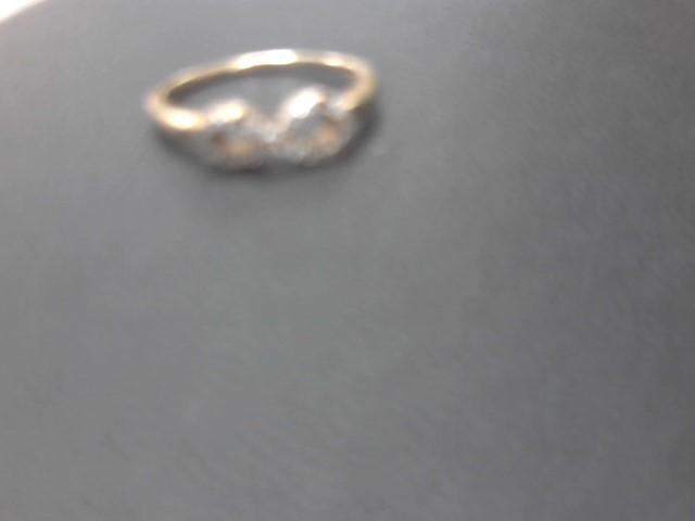 Lady's Diamond Cluster Ring 18 Diamonds .18 Carat T.W. 10K Yellow Gold 1.8g