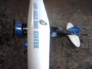 ERTL DIECAST Toy WARNER BROTHERS TOY STUNT AIRPLANE