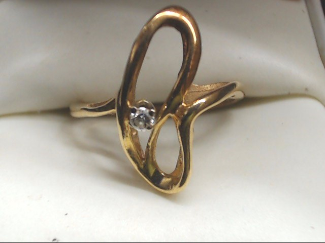 Lady's Diamond Solitaire Ring .07 CT. 14K Yellow Gold 2.5g Size:6.5