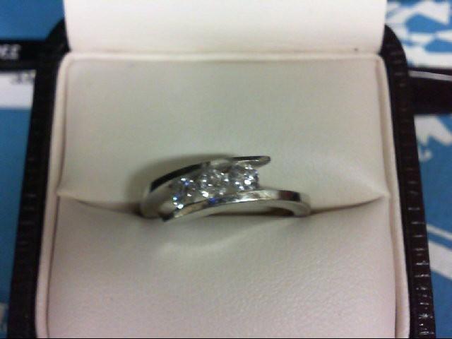 Lady's Diamond Wedding Band 3 Diamonds 0.3 Carat T.W. 14K White Gold 3.3g