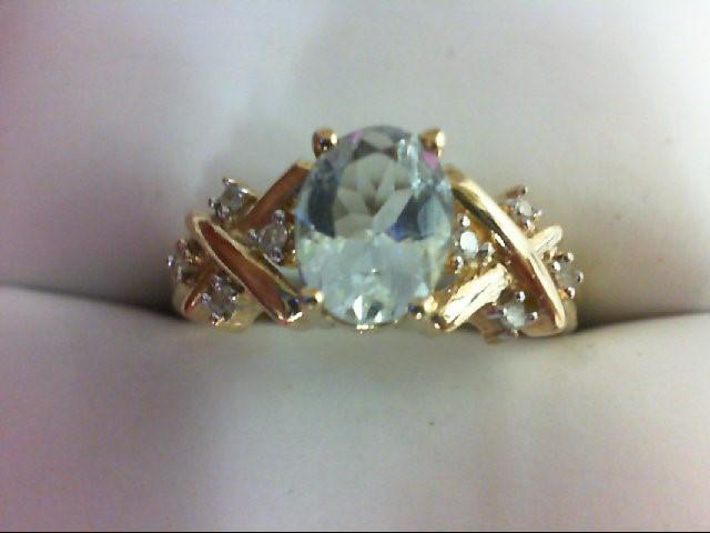 Synthetic Blue Stone Lady's Stone & Diamond Ring 8 Diamonds 0.08 Carat T.W. 10K