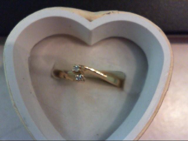 Lady's Diamond Fashion Ring 2 Diamonds .04 Carat T.W. 10K Yellow Gold 1.7g