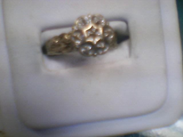 Lady's Diamond Cluster Ring 7 Diamonds .07 Carat T.W. 14K Yellow Gold 4.7g