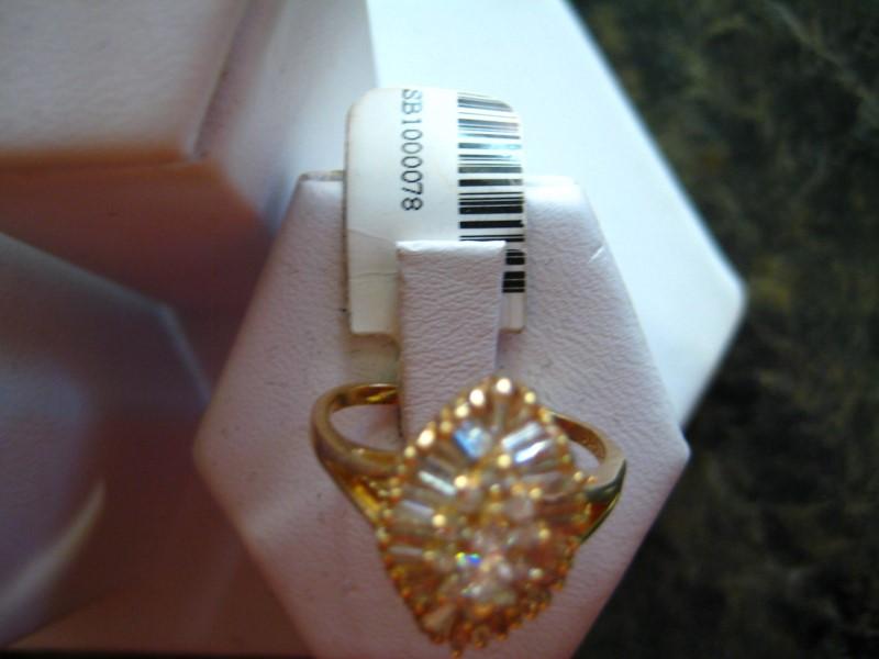 Lady's Gold-Diamond Anniversary Ring .01 CT. 14K Yellow Gold 4g