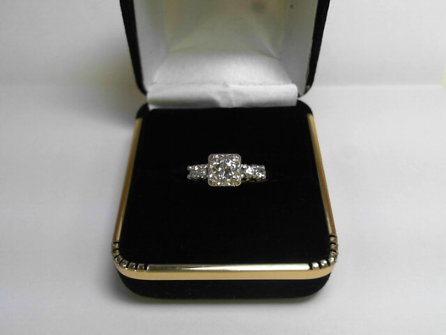 Lady's Diamond Solitaire Ring 5 Diamonds .66 Carat T.W. 14K Yellow Gold 2dwt
