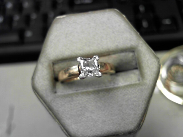 Lady's Diamond Solitaire Ring .69 CT. 14K Yellow Gold 4.8g Size:5