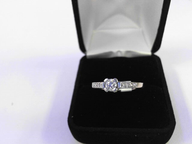 Lady's Diamond Solitaire Ring 9 Diamonds .66 Carat T.W. 14K White Gold 1.8dwt