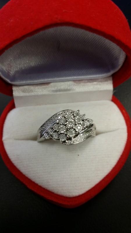 Lady's Silver-Diamond Ring 11 Diamonds .11 Carat T.W. 925 Silver 4.7g Size:6.5