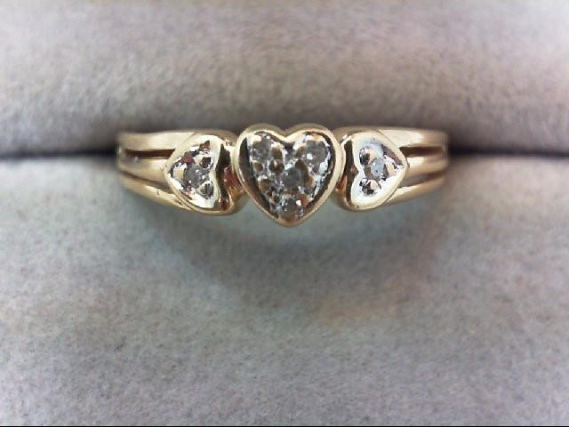 Lady's Diamond Fashion Ring 6 Diamonds .06 Carat T.W. 10K Yellow Gold 2g