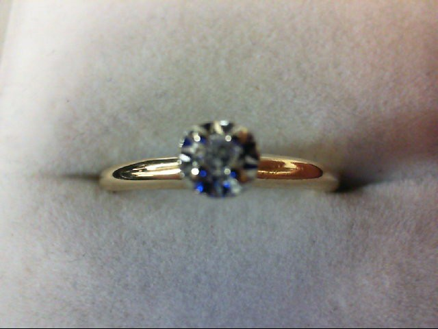 Lady's Diamond Solitaire Ring 0.03 CT. 14K Yellow Gold 1.6g