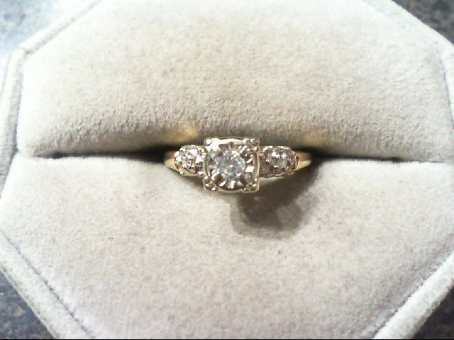 Lady's Diamond Engagement Ring 3 Diamonds .14 Carat T.W. 14K Yellow Gold 2.2g