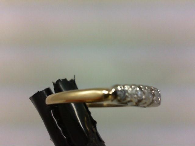 Lady's Diamond Wedding Band 6 Diamonds .16 Carat T.W. 14K White Gold 2.4g