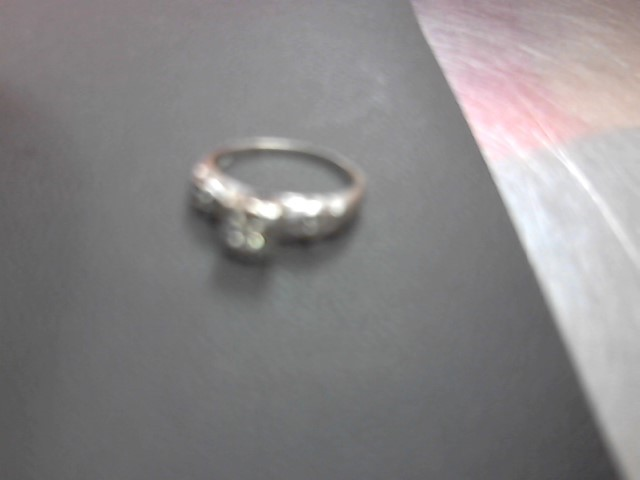 Lady's Diamond Fashion Ring 3 Diamonds .03 Carat T.W. 14K White Gold 1.9g