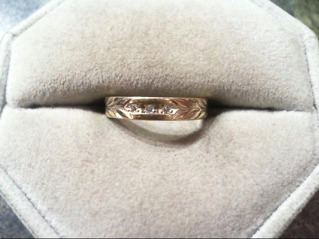 Lady's Diamond Wedding Band 3 Diamonds .03 Carat T.W. 10K Yellow Gold 1.7g