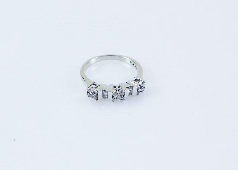 Lady's Diamond  Ring 21 Diamonds .21 Carat T.W. 10K WG size 8