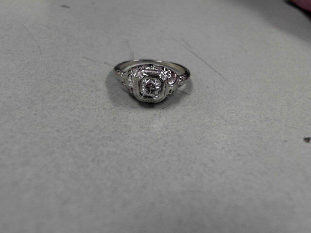 Lady's Diamond Solitaire Ring 0.13 CT. 18K White Gold 1.44g Size:4.5