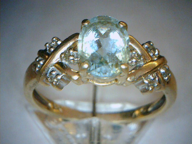 Aquamarine Lady's Stone & Diamond Ring 4 Diamonds .04 Carat T.W.