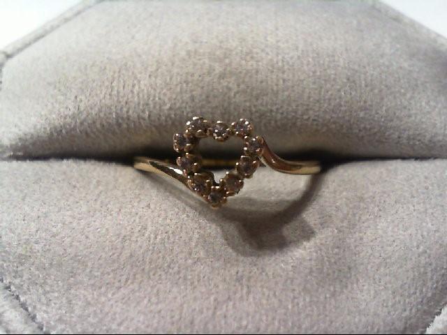Lady's Diamond Fashion Ring 10 Diamonds .10 Carat T.W. 10K Yellow Gold 1.8g