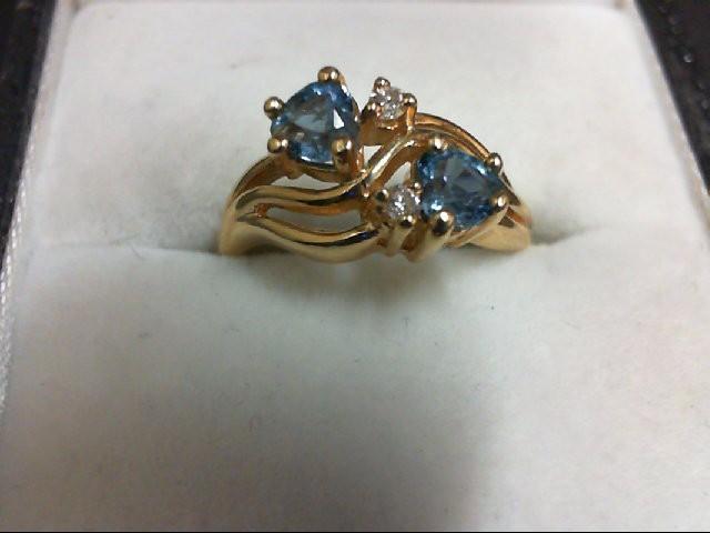 Blue Topaz Lady's Stone & Diamond Ring 2 Diamonds 0.04 Carat T.W. 14K Yellow Gol