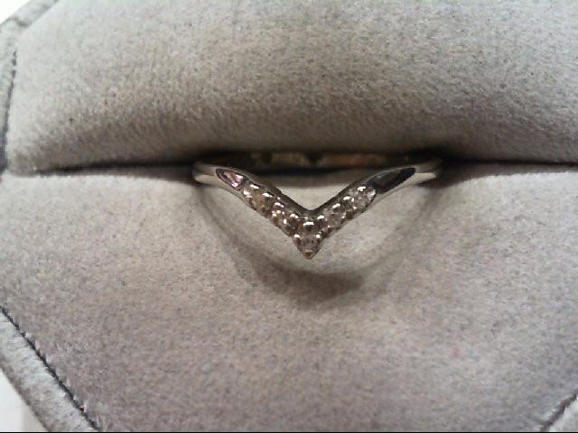 Lady's Diamond Fashion Ring 7 Diamonds .07 Carat T.W. 14K Yellow Gold 1g