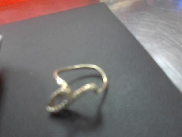 Lady's Diamond Fashion Ring 19 Diamonds .20 Carat T.W. 10K Yellow Gold 2.3g