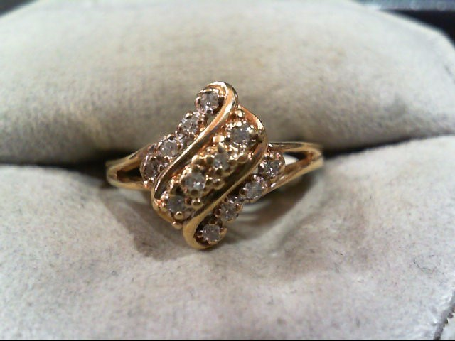 Lady's Diamond Cluster Ring 12 Diamonds .12 Carat T.W. 10K Yellow Gold 2.4g