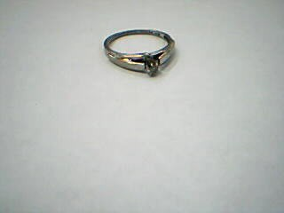 Lady's Diamond Solitaire Ring .01 CT. 10K White Gold 1.5g Size:6.5