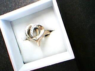 Lady's Diamond Fashion Ring 6 Diamonds .06 Carat T.W. 10K Yellow Gold 2.5g
