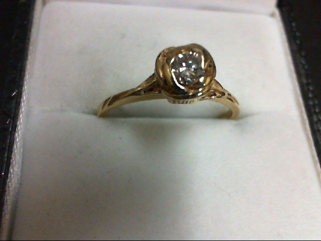 Lady's Diamond Solitaire Ring 0.15 CT. 14K Yellow Gold 2.6g