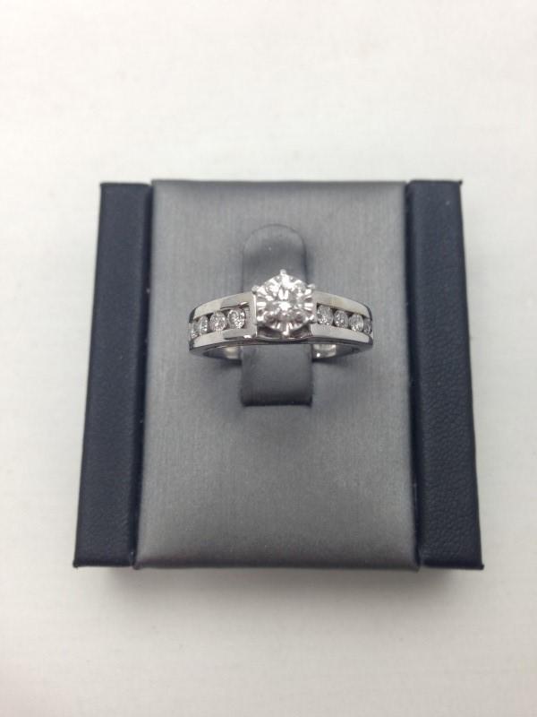 Lady's Diamond Fashion Ring 9 Diamonds .60 Carat T.W. 14K White Gold 2.8dwt