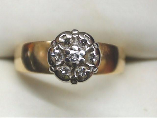 Lady's Diamond Cluster Ring 7 Diamonds .14 Carat T.W. 14K Yellow Gold 2.8g