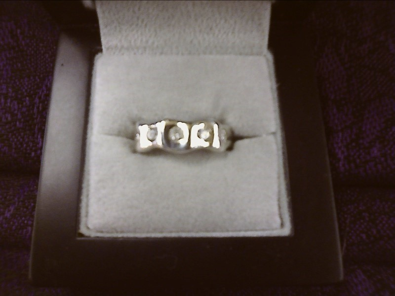 STERLING SILVER RING WITH 5 CLEAR STONES IN WAVE DESIGN SIZE: 4 1/2